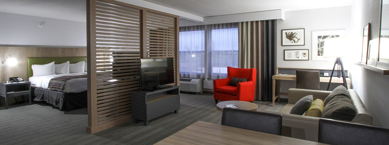 GreenTree Inn and Suites - suite-king-bed-1